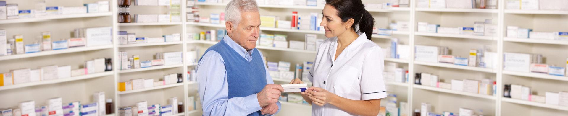 elder man getting a prescription from a pharmacist